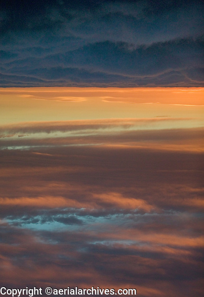 aerial photograph of layers of clouds over San Francisco Bay at dawn