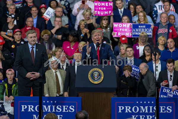 United States President Donald J. Trump speaks as Rick Saccone, Republican Congressional candidate for Pennsylvania's 18th district, looks on during a Make America Great Again campaign rally at Atlantic Aviation in Moon Township, Pennsylvania on March 10th, 2018. Photo Credit: Alex Edelman/CNP/AdMedia