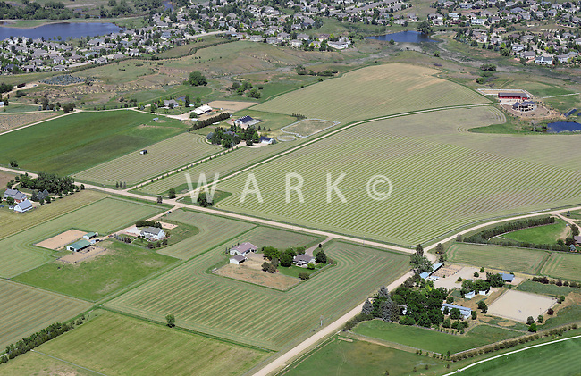 Aerial of famland and housing sprawl east of Ft. Collins, Colorado.  June 2014
