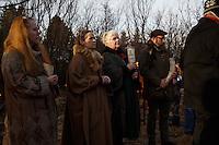 Jóhanna Harðardóttir and other priests (or gothi) of the neo-pagan Ásatrúarfélagið or Asatru association watch the hight of the solar eclipse in Reykjavik, Iceland.