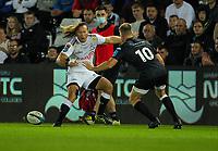8th October 2021;  Swansea.com Stadium, Swansea, Wales; United Rugby Championship, Ospreys versus Sharks; Werner Kok of Cell C Sharks kicks the ball past Gareth Anscombe of Ospreys