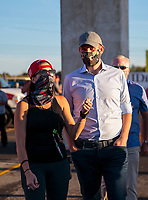 Sep 4, 2020; Clermont, Indiana, United States; Eric Trump, son of United States President Donald Trump talks with NHRA crew member Courtney Enders during NHRA qualifying for the US Nationals at Lucas Oil Raceway. Mandatory Credit: Mark J. Rebilas-USA TODAY Sports