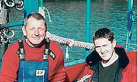 Pictured: Undated picture of Gareth Willington and his son Daniel, taken from obituary page<br /> Re: Lifejackets should be mandatory for all fishermen, acoording to a coroner, after a father and son died off Pembrokeshire.<br /> 59 year old Gareth Willington, from Carew, died after his boat The Harvester sank off St David's Head on 28 April. The body of his 32 year old son Daniel, has never been recovered.<br /> An inquiry found that when they went overboard, none of them were wearing buoyancy aids.<br /> Pembrokeshire coroner Mark Layton ruled Daniel's death was accidental while his father's was misadventure.<br /> An investigation report said the men were throwing lobster pots into the sea before they died.<br /> Gareth Willington was not wearing a lifejacket when he was found, a report by the Marine Accident Investigation Branch (MAIB) said.<br /> The boat, which operated out of Milford Haven, smashed into rocks and broke up when it ran aground.