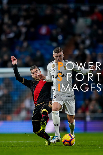 Toni Kroos of Real Madrid (R) is tackled by Adrian Embarba Blazquez of Rayo Vallecano follows during the La Liga 2018-19 match between Real Madrid and Rayo Vallencano at Estadio Santiago Bernabeu on December 15 2018 in Madrid, Spain. Photo by Diego Souto / Power Sport Images