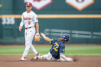 Michigan Wolverines outfielder Jordan Brewer (22) steals second base in front of Mike Salvatore (16) during Game 6 of the NCAA College World Series against the Florida State Seminoles on June 17, 2019 at TD Ameritrade Park in Omaha, Nebraska. Michigan defeated Florida State 2-0. (Andrew Woolley/Four Seam Images)