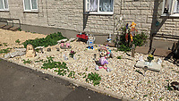 BNPS.co.uk (01202 558833)<br /> Pic: EmmaCollins/BNPS<br /> <br /> Pictured: The memorial garden Emma created. <br /> <br /> A grieving mother who built a memorial garden in tribute to her late son has spoken of her devastation after she was made to remove it by a housing association. <br /> <br /> Emma Collins made the garden on a small patch of land outside her ground floor flat in memory of her 16 year old son Daniel who died in a quad biking accident. <br /> <br /> The 14ft  by 6ft space was filled with flowers, gnomes, lights, and a picture of Daniel but is now an empty, weed-infested gravel bed.
