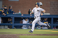 Michigan Wolverines first baseman Jimmy Kerr (15) runs towards home plate during the NCAA baseball game against the Eastern Michigan Eagles on May 8, 2019 at Ray Fisher Stadium in Ann Arbor, Michigan. Michigan defeated Eastern Michigan 10-1. (Andrew Woolley/Four Seam Images)