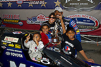 Sept. 5, 2011; Claremont, IN, USA: NHRA top fuel dragster driver Antron Brown celebrates with his family after winning the US Nationals at Lucas Oil Raceway. Mandatory Credit: Mark J. Rebilas-