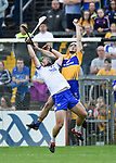 Tom Devine of Waterford  in action against Patrick O Connor of Clare during their Munster  championship round robin game at Cusack Park Photograph by John Kelly.