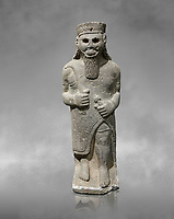 Hittite baslat sculptute of a male, late Hittite Period - 900-700 BC. Adana Archaeology Museum, Turkey. Against a grey art background