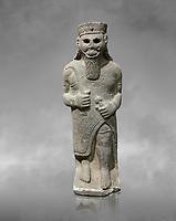 Hittite baslat sculptute of a male, late Hittite Period - 900-700 BC. Adana Archaeology Museum, Turkey. Against a grey art background