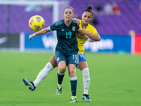 ORLANDO, FL - FEBRUARY 18: Mariana Larroquette #19 of Argentina is defended by Camila #18 of Brazil during a game between Argentina and Brazil at Exploria Stadium on February 18, 2021 in Orlando, Florida.