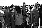 Somali women wait in queue outside a registration and food distribution point in the IFO Camp of the Dadaab refugee camp in northeastern Kenya. Hundreds of thousands of refugees are fleeing lands in Somalia due to severe drought and arriving in what has become the world's largest refugee camp. Photo: Sanjit Das/Panos