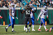 Jacksonville Jaguars Donald Payne (52) throws his arms up during an NFL Wild-Card football game against the Buffalo Bills, Sunday, January 7, 2018, in Jacksonville, Fla.  (Mike Janes Photography)