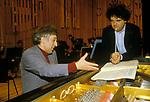 Vladimir Ashkenazy at piano and conductor Uri Segal rehearsals with Royal Philharmonic Orchestra at the Barbican 1990s London UK