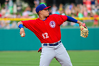Buffalo Bisons third baseman Gio Urshela (12) throws to first base between innings during an International League game against the Indianapolis Indians on July 28, 2018 at Victory Field in Indianapolis, Indiana. Indianapolis defeated Buffalo 6-4. (Brad Krause/Four Seam Images)
