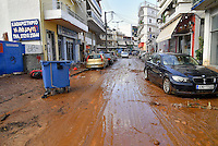 Pictured: Mud on the streets and cars piled on top of others in Messini, near the town of Kalamata, Messinia, Greece. Wednesday 07 September 2016<br /> Re: Severe flash flooding has affected parts of Messinia County in southern Greece.