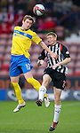 Dunfermline v St Johnstone..24.12.11   SPL .Liam Craig outjumps Jason Thomson.Picture by Graeme Hart..Copyright Perthshire Picture Agency.Tel: 01738 623350  Mobile: 07990 594431