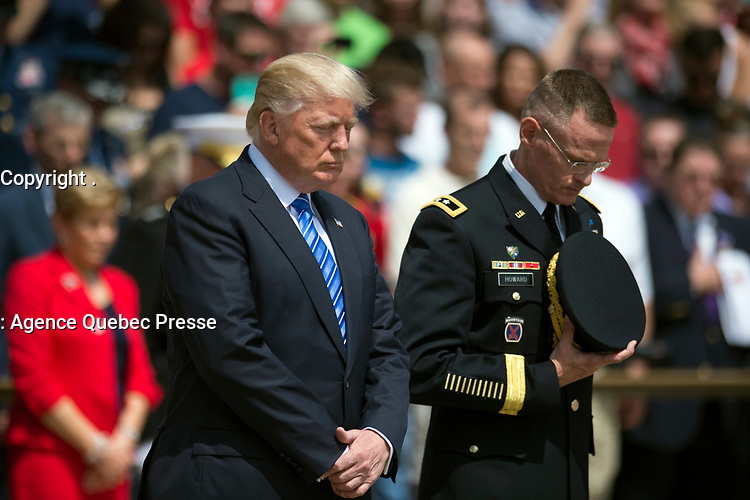 President Donald J. Trump and Maj. Gen. Michael L. Howard bow their heads in a moment of silence during a wreath laying ceremony at the Tomb of the Unknowns in Arlington National Cemetery in Arlington, Va. May 29, 2017. Howard is the commanding general of Joint Force Headquarters National Capital Region and the U.S. Army Military District of Washington. (DoD photo by EJ Hersom)