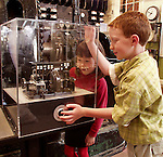 Visitors of all ages enjoy learning at the historic Estes Park Power Plant along Fall River west of Estes Park, Colorado, Rocky Mountains