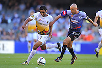 MELBOURNE, AUSTRALIA - JANUARY 26, 2010: Kevin Muscat from Melbourne Victory tackles Paul Ifill from Wellington Phoenix in round 19 of the A-league match between Melbourne Victory and Wellington Phoenix FC at Etihad Stadium on January 26, 2010 in Melbourne, Australia. Photo Sydney Low www.syd-low.com
