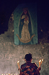 Praying to Virgin Mary, Blessed Mother, candles, church, woman,Daily life; Mexico, Festivals, Izamal, stone in church from Mayan temple
