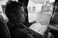 preparations: Bjorn Leukemans (BEL/Wanty-GroupeGobert) checking the roadbook in the teambus<br /> <br /> Paris - Roubaux 2014