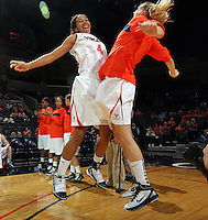 Nov. 14, 2010; Charlottesville, VA, USA;  Virginia center Simone Egwu (4) chest bumps Virginia forward Jayna Hartig (32) before the start of the game against Mt. St. Mary's at the John Paul Jones Arena.  Mandatory Credit: Andrew Shurtleff-