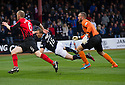 Dundee's David Clarkson goes down in the box but if booked for diving.