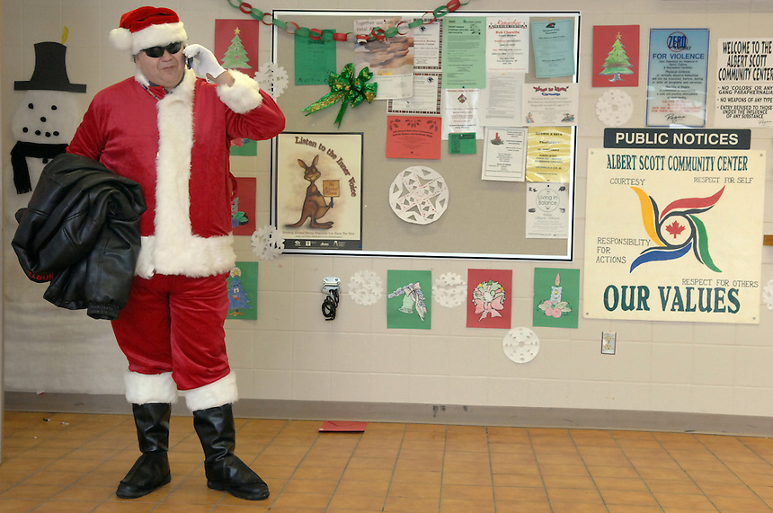 Santa-for-hire Perry Boyko takes a call during a Christmas celebration at the Albert Scott Community Centre. MARK TAYLOR GALLERY