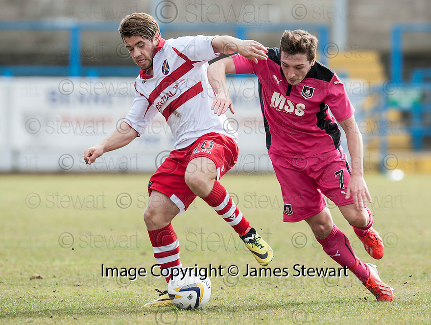 Stirling's Andy Stirling holds off Airdrie's Scott Gray.
