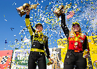 May 6, 2018; Commerce, GA, USA; NHRA top fuel driver Leah Pritchett (left) and funny car driver Courtney Force celebrate after winning the Southern Nationals at Atlanta Dragway. Mandatory Credit: Mark J. Rebilas-USA TODAY Sports