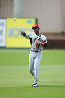 Hickory Crawdads shortstop Michael De Leon (1) warms up in the outfield prior to the game against the Kannapolis Intimidators at CMC-Northeast Stadium on April 17, 2015 in Kannapolis, North Carolina.  The Crawdads defeated the Intimidators 9-5 in game one of a double-header.  (Brian Westerholt/Four Seam Images)