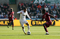Saturday 2nd March 2013<br /> Pictured: (L-R) Wayne Routledge, Mapou Yanga-Mbiwa.<br /> Re: Barclays Premier Leaguel, Swansea  v Newcastle at the Liberty Stadium in Swansea.