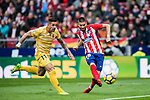 Yannick Ferreira Carrasco (R) of Atletico de Madrid shoots past Francisco Aday Benitez of Girona FC during the La Liga 2017-18 match between Atletico de Madrid and Girona FC at Wanda Metropolitano on 20 January 2018 in Madrid, Spain. Photo by Diego Gonzalez / Power Sport Images