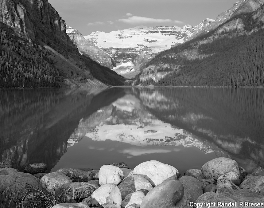 """""""Lake Louise"""" <br /> Banff National Park; Alberta, Canada<br /> <br /> A popular destination for many visitors to Banff Park is Lake Louise. The lake is flanked by gorgeous mountains and offers views of Victoria Glacier at the far end of the lake. The camera was positioned on the shoreline close to the parking lot to make this black and white photograph shortly after sunrise."""