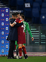 Football, Serie A: AS Roma - Bologna, Olympic stadium, Rome, April 11, 2021. <br /> Roma's coach Paulo Fonseca (l) celebrates with Roma's Gianluca Mancini (r)i after winning 1-0 the Italian Serie A football match between AS Roma and Bologna at Rome's Olympic stadium, Rome, on April 11, 2021.  <br /> UPDATE IMAGES PRESS/Isabella Bonotto