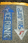 Painted signs on the sidewalk in Steamboat Springs, Colorado. © Michael Brands. 970-379-1885.