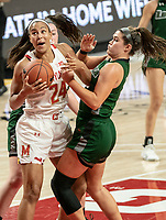 COLLEGE PARK, MD - DECEMBER 8: Stephanie Karcz #10 of Loyola clashes with Stephanie Jones #24 of Maryland during a game between Loyola University and University of Maryland at Xfinity Center on December 8, 2019 in College Park, Maryland.