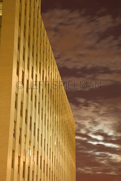 Office Building in Lower Manhattan's Wall Street Financial District and Cloudy Sky on a Moonlit Night, New York City, New York State, USA