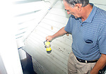 """PLYMOUTH, CT.-28 AUGUST 2011-082811JW03-  Homeowner Eugene Kaczypenski shows the level of water and sewage in his basement after the Pequabuck River overflowed its banks due to the rainfall from tropical storm Irene Sunday morning. Kaczypenski said that """"this is worse than the Flood of 55'"""".<br /> Jonathan Wilcox Republican American"""