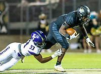 Cade Fields (33) of Fayetteville takes down Joshua Ficklin (1) of  Bentonville at Tigers Stadium, Bentonville, Arkansas on Friday, October 16, 2020 / Special to NWA Democrat-Gazette/ David Beach