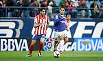 Atletico de Madrid's Raul Garcia against Xerez's Armenteros during La Liga match, April 14, 2010. (ALTERPHOTOS/Alvaro Hernandez).