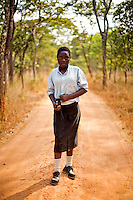 """14 year old Grace Bwalya from Chalilo school in Sereje district, on her first safari in Kasanka National Park. """"I am very happy to see Puku [antelope] for the first time and liked the arrangement of the teeth of the elephant - it is the first time I have seen that. I put my hand in the bit where the tusks were! I will tell my parents not to buy poached meat because it is the animals that bring in tourism. And the tourism sector has given a lot of jobs to a lot of people. So if poaching is allowed then there will be less jobs."""" Local schools and women's groups are regularly brought into Kasanka, which is unique in the country and unusual in Africa as it is privately managed and owned by a trust. People are able to see animals flourishing in land which was once free reign for poachers. Combined with anti-poaching scouts, the education programme is on the frontline of conservation methods in the park, showing local people wild animals in their natural habitat."""