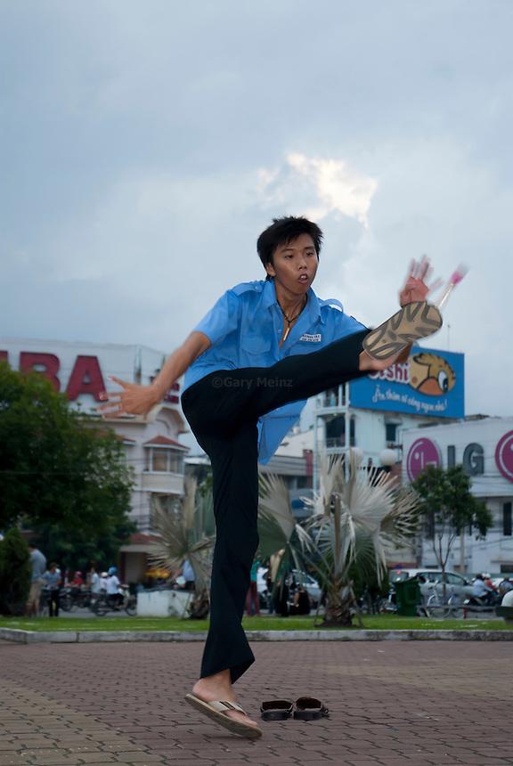 High School student plays hack sack in Ho Chi Minh City, Vietnam