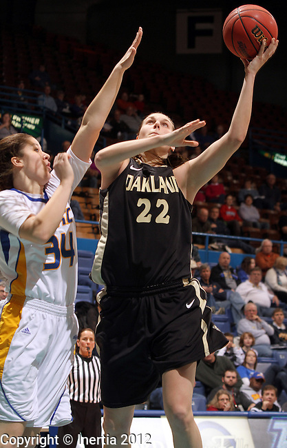 SIOUX FALLS, SD - MARCH 4:  Brittany Carnago #22 from Oakland University lays the ball up past Hailey Houser #34 from UMKC in the second half of their game Sunday afternoon during the 2012 Summit League Tournament at the Sioux Falls Arena. (Photo by Dave Eggen/Inertia)