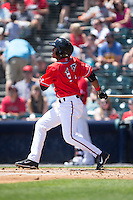 Rando Moreno (17) of the Richmond Flying Squirrels follows through on his swing against the Bowie Baysox at The Diamond on May 25, 2015 in Richmond, Virginia.  The Flying Squirrels defeated the Baysox 6-1. (Brian Westerholt/Four Seam Images)