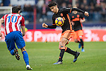 Carlos Soler of Valencia CF (right) competes for the ball with  Yannick Ferreira Carrasco of Atletico de Madrid  during the match Atletico de Madrid vs Valencia CF, a La Liga match at the Estadio Vicente Calderon on 05 March 2017 in Madrid, Spain. Photo by Diego Gonzalez Souto / Power Sport Images