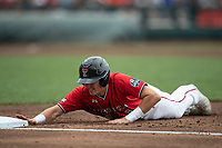 Texas Tech Red Raiders outfielder Kurt Wilson (8) dives back to first base during Game 5 of the NCAA College World Series against the Arkansas Razorbacks on June 17, 2019 at TD Ameritrade Park in Omaha, Nebraska. Texas Tech defeated Arkansas 5-4. (Andrew Woolley/Four Seam Images)