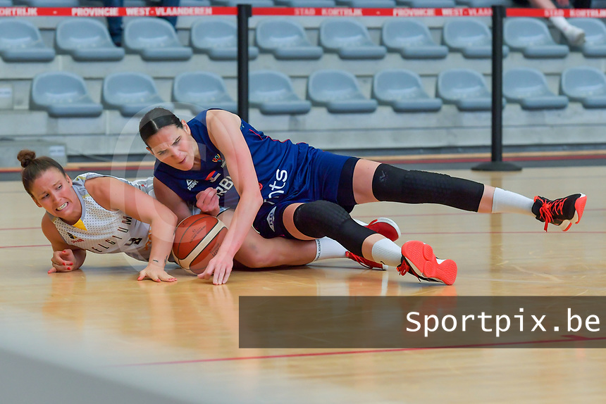 Marjorie Capreaux (9) of Belgium and Sonja Vasic (5) of Serbia pictured during a basketball game between the national teams of Belgium , called the Belgian Cats , and Serbia on Friday 28 th of May 2021 in Kortrijk , Belgium . PHOTO SPORTPIX.BE | SPP | STIJN AUDOOREN